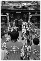 Drumners and dragon dancers in front of Thien Hau Pagoda, district 5. Cholon, District 5, Ho Chi Minh City, Vietnam ( black and white)
