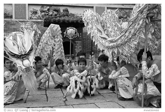 Dragon dancers at rest, Thien Hau Pagoda. Cholon, District 5, Ho Chi Minh City, Vietnam (black and white)