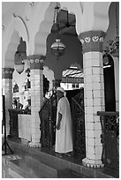 Muslim man in worship attire, Cholon Mosque. Cholon, District 5, Ho Chi Minh City, Vietnam (black and white)