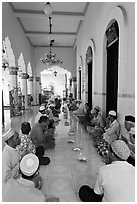 Men sitting in gallery, Cholon Mosque. Cholon, District 5, Ho Chi Minh City, Vietnam ( black and white)