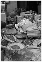 Woman preparing traditional medicine ingredients. Cholon, Ho Chi Minh City, Vietnam (black and white)