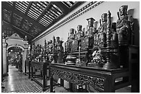 Row of statues, Giac Lam Pagoda. Ho Chi Minh City, Vietnam (black and white)