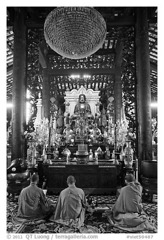 Monks in worship, Giac Lam Pagoda. Ho Chi Minh City, Vietnam