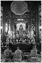 Monks in worship, Giac Lam Pagoda. Ho Chi Minh City, Vietnam (black and white)