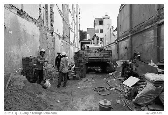 Buiding in construction in narrow space. Ho Chi Minh City, Vietnam (black and white)
