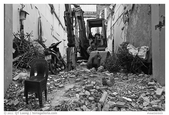 Building demolition works. Ho Chi Minh City, Vietnam (black and white)