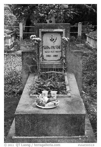 Tomb with fruit and refreshments offering. Ben Tre, Vietnam (black and white)