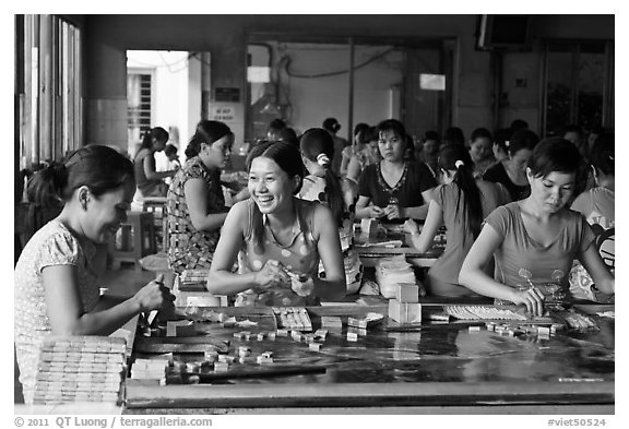Productin of candy through manual labor. Ben Tre, Vietnam (black and white)