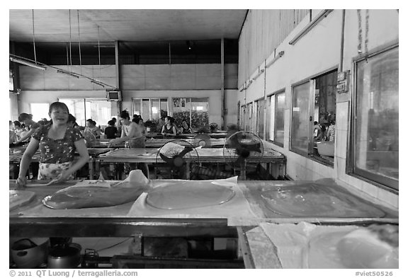 Uncut coconut candy in factory. Ben Tre, Vietnam (black and white)