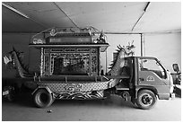 Funeral truck, Saigon Caodai temple. Ho Chi Minh City, Vietnam (black and white)