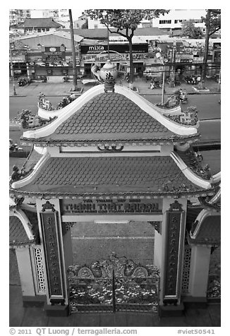 Exterior gate and street from above, Saigon Caodai temple. Ho Chi Minh City, Vietnam