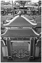 Exterior gate and street from above, Saigon Caodai temple, district 5. Ho Chi Minh City, Vietnam (black and white)