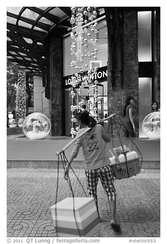 Food vendor and luxury store. Ho Chi Minh City, Vietnam (black and white)
