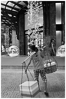 Food vendor and luxury store. Ho Chi Minh City, Vietnam ( black and white)