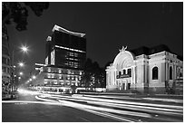 Opera house and streaks from traffic at night. Ho Chi Minh City, Vietnam (black and white)