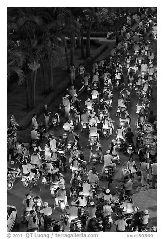 Heavy motorcycle traffic on Nguyen Hue boulevard at night. Ho Chi Minh City, Vietnam (black and white)