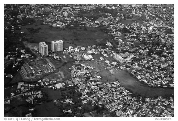 Aerial view of houses and high-rises on the outskirts of the city. Ho Chi Minh City, Vietnam