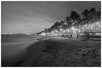 Beach bordered by resorts at night. Mui Ne, Vietnam (black and white)