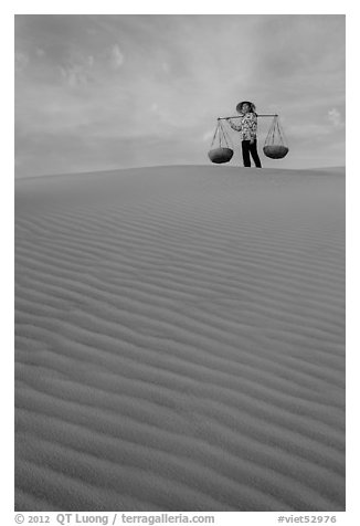 Woman on top of dune field. Mui Ne, Vietnam (black and white)