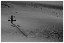 Shadows of woman on dune field. Mui Ne, Vietnam (black and white)