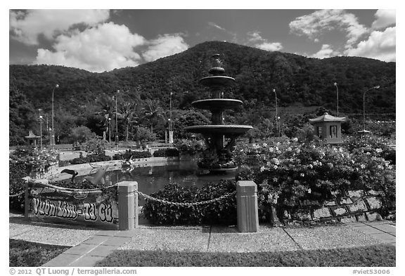 Fountain and forested peak. Ta Cu Mountain, Vietnam (black and white)