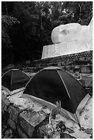 Child and tents set up below head of Buddha statue. Ta Cu Mountain, Vietnam (black and white)