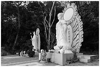 Two Buddhist statues. Ta Cu Mountain, Vietnam (black and white)
