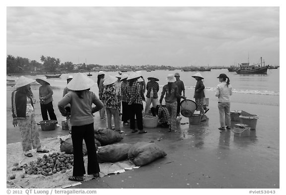 Shore activity in front of Lang Chai fishing village. Mui Ne, Vietnam (black and white)