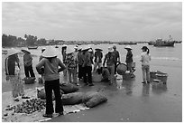 Shore activity in front of Lang Chai fishing village. Mui Ne, Vietnam ( black and white)