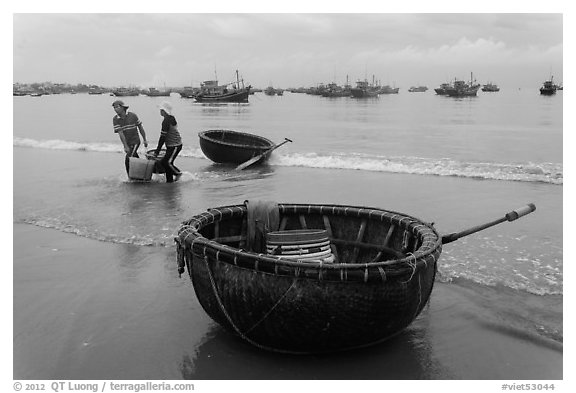 Traditional roundboats on beach. Mui Ne, Vietnam (black and white)