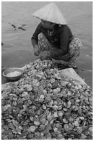 Woman opening scallops. Mui Ne, Vietnam (black and white)