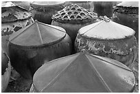 Amphorae for storage of traditional Vietnamese fish sauce Nuoc Mam. Mui Ne, Vietnam (black and white)