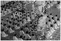 Column and worshippers, Cao Dai Holy See temple. Tay Ninh, Vietnam (black and white)