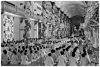 Rows of worshippers in Great Temple of Cao Dai. Tay Ninh, Vietnam ( black and white)