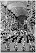 Rows of worshippers in Cao Dai Holy See. Tay Ninh, Vietnam (black and white)
