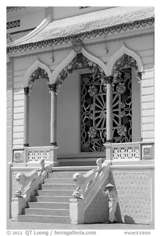 Cao Dai follower and temple detail. Tay Ninh, Vietnam (black and white)