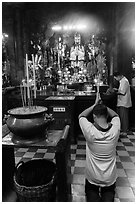Worshippers inside Jade Emperor Pagoda. Ho Chi Minh City, Vietnam ( black and white)