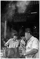 Worshippers burning incense, Thien Hau Pagoda. Cholon, District 5, Ho Chi Minh City, Vietnam (black and white)