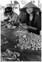 Villagers wrapping coconut candy, Phoenix Island. My Tho, Vietnam (black and white)