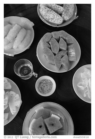 Fresh fruit quartered and served on table, Phoenix Island. My Tho, Vietnam (black and white)