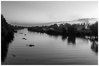 River and homes at sunset. Mekong Delta, Vietnam (black and white)