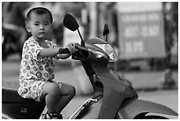 Boy on scooter. Can Tho, Vietnam (black and white)