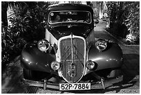 Old Citroen car in garden. Ho Chi Minh City, Vietnam (black and white)