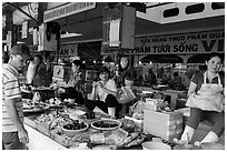 Vendors in Ben Thanh market. Ho Chi Minh City, Vietnam ( black and white)