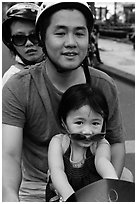 Family on motorbike with sunglasses. Ho Chi Minh City, Vietnam (black and white)