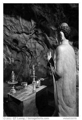Buddha statue in narrow cave, Marble Mountains. Da Nang, Vietnam (black and white)