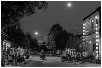 Street at dusk with moon and lanterns. Hoi An, Vietnam ( black and white)