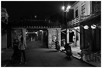 Night street scene near the Japanese Bridge. Hoi An, Vietnam ( black and white)