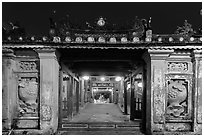 Covered Japanese Bridge gate at night. Hoi An, Vietnam (black and white)