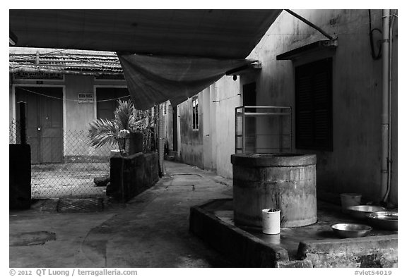 Well and alley. Hoi An, Vietnam (black and white)